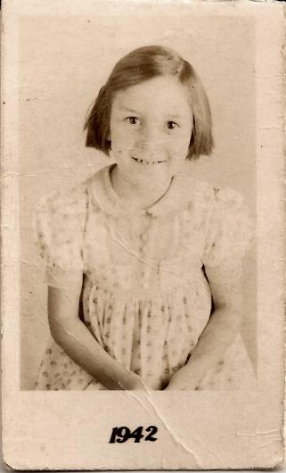 A portrait of Josie Sandoval, around age 7.